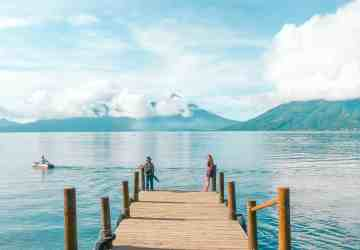 sitting on the dock of san marcos la laguna at lake atitlan