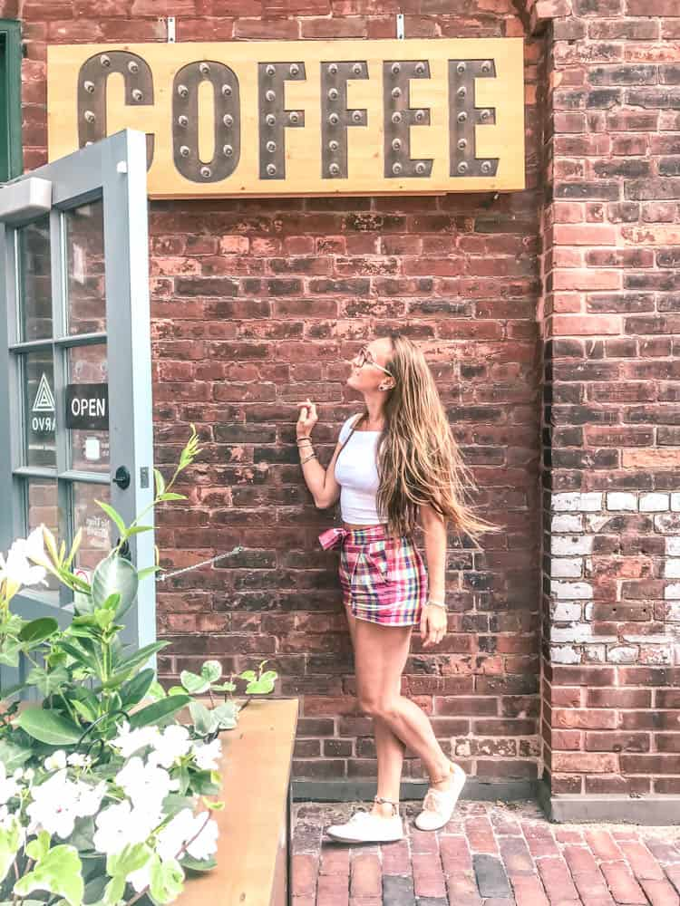 standing out front of arvo coffee in the historic distillery district of Toronto