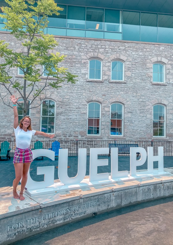Sitting in front of the Guelph sign in downtown Guelph