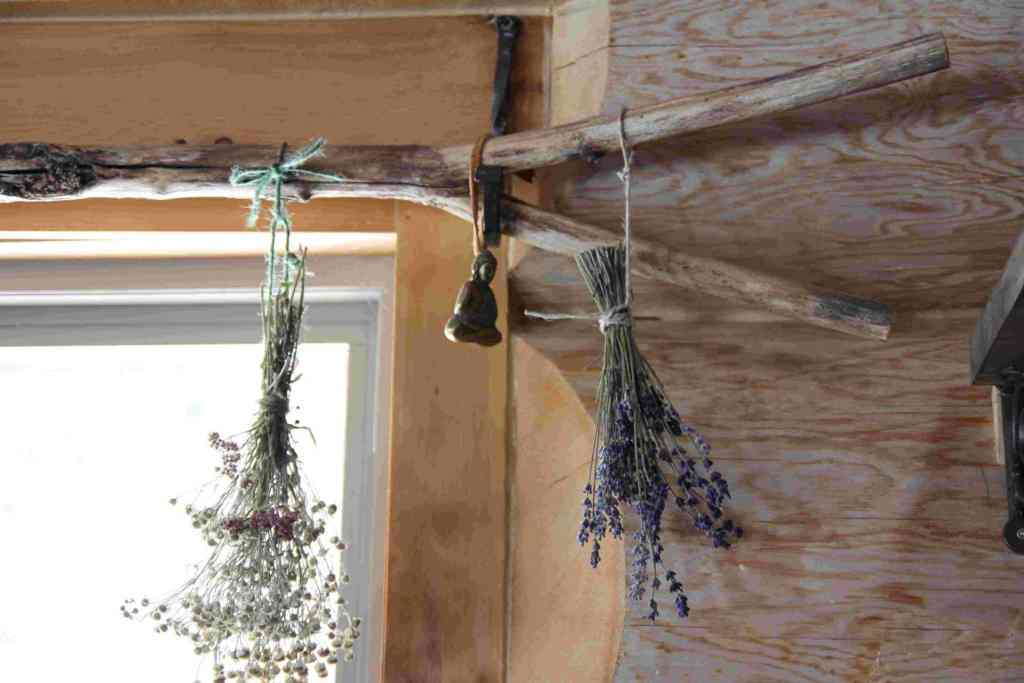 10 Rustic Country Kitchen Décor Ideas for Your Homestead - Using tree branches as curtain rods