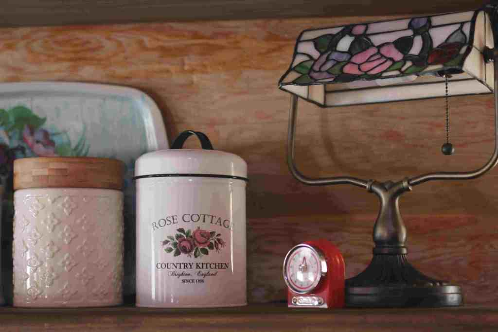 10 Rustic Country Kitchen Décor Ideas for Your Homestead- Decorate your kitchen with vintage finds like this old stained glass desk lamp inspired by a scene in the film Divine Secrets of the Ya Ya Sisterhood.