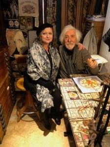 Photo of Anastasia Haysler and Osvaldo Menegazzi at his work table.