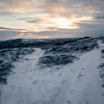 Snowy footpaths in burley moor during sunrise