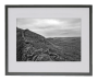 Hadrian's Wall in the Northumberland landscape in black and white in black frame