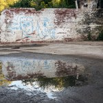 Derelict wall in reflection