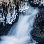 Ice covered grass above waterfall