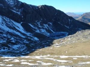 The frozen Llyn Du'r Arddu lake in the Cwm Brwynog