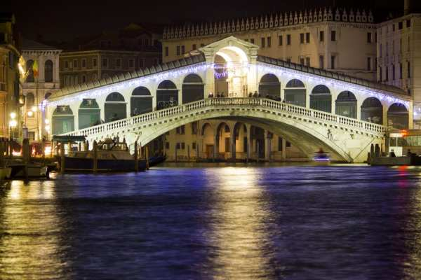 Venice is gorgeous year round, but heavy rains in the winter can be a pain for travelers. Illuminated Rialto Bridge