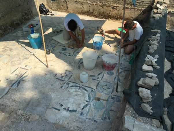 The American Institute for Roman Culture unearth ancient Roman tiles.