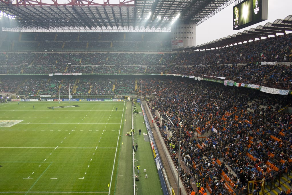 San Siro stadium filled with fans. Going to see a soccer game at this massive stadium is one of the best things to do in Milan in the fall.