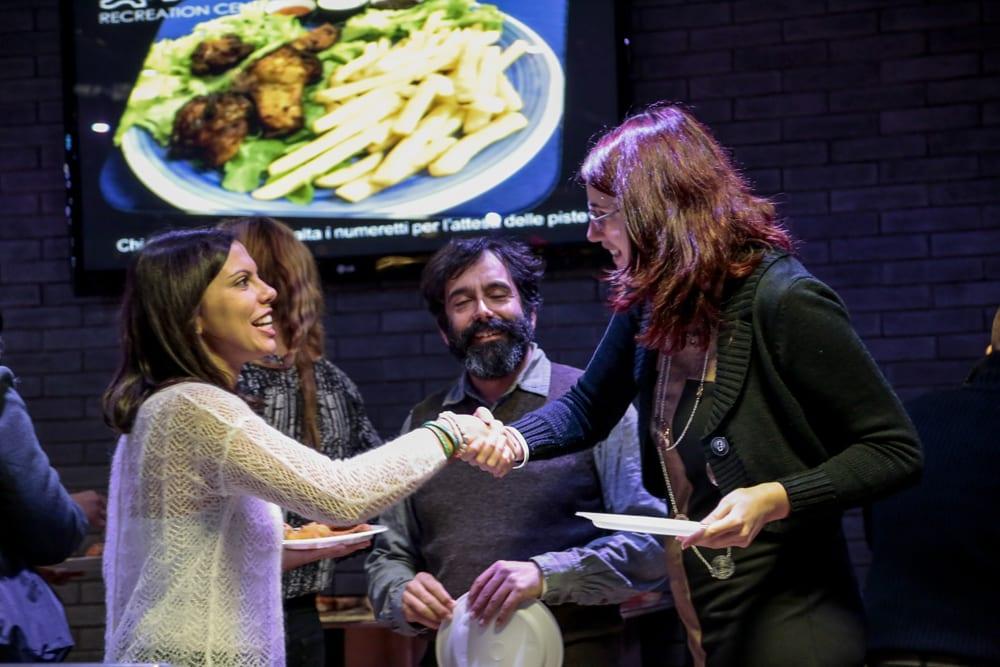 Partner Relations Executive Loredana Cardinale greets Francesca Romana Valente and Sergio Pileggi.