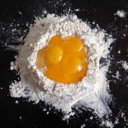 "Eggs in ""0"" flour - the first step of making fresh pasta | Photo by Joy via Flickr. https://www.flickr.com/photos/joyosity/16694949202/in/photolist-rrgYKL-a9KNqp-aaxZ7N-4yf3Nt-b5Le2x-7j83jo-8TNv9u-5wDyb7-9523XA-qfUh6N-7rsbs1-jP5qNr-9S6pTG-5o5hzD-7VQ88o-qkWKUT-7o3Cec-cARtbU-9yZjye-dCV7y7-6mSBQS-6jUK4a-cziT8U-k4Zj4L-a4P5qV-8aapmP-qR2trL-8wM78u-acdbqQ-nYhJCr-cANLDL-81oSg1-bW1hfF-o5eYCx-aAPRPu-4zwMKe-7YJCUY-2UiSj5-9dwSxn-HfK87E-8Shf5F-dJSzHL-8qKLM4-2AfjRB-5YzWH6-7kyWSJ-8f9NBn-6giGXV-5uTxVr-wNNV1S"