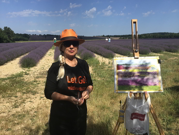 artist painting the lavender fields during our July painting workshop in France