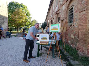 Artist in Tuscany showing his paintings during Walk the Arts art retreats in Italy