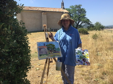 Artist showing her oil painting during our art workshop in Provence open to all levels