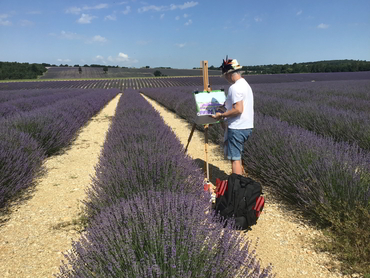 Artist painting the lavender fields during our art workshop in Provence France