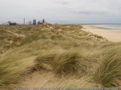 Sand dunes at Redcar A view along sand dunes towards Redcar's steelworks.