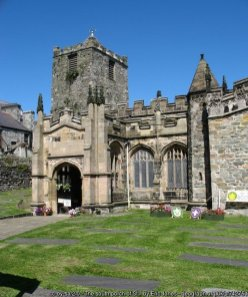 The south porch of St Cybi's Church The south porch and the south aisle were added to the church shortly before the Protestant Reformation. A section of the original wall of the Roman fort can be seen to the left of the porch.