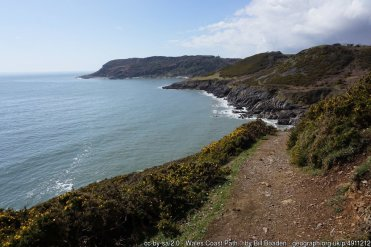 Wales Coast Path approaching Seven Slades Pwlldu Point is the main headland ahead
