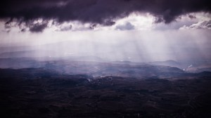 dark clouds over city and light shining down