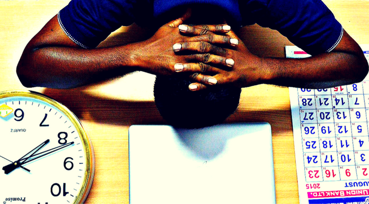 5 sneaky ways stress ruins your finances stressed man working