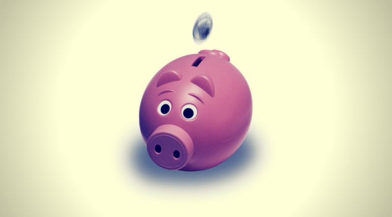 picture of piggy bank to save money for a budget friendly vacation