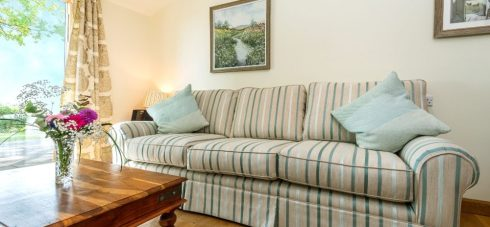 Hedgehunter Cottage at Wallops Wood living room is plush and comfy