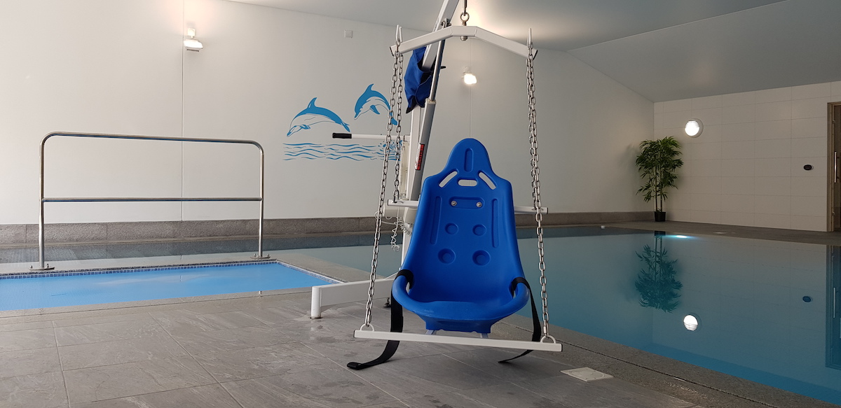 An accessible pool hoist whioch is hard moulded in blue