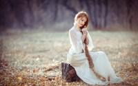 White dress girl, sitting on stump, long blonde hair ...