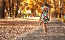 Woman Wearing Floral Dress Walking In Gray Pavement Road