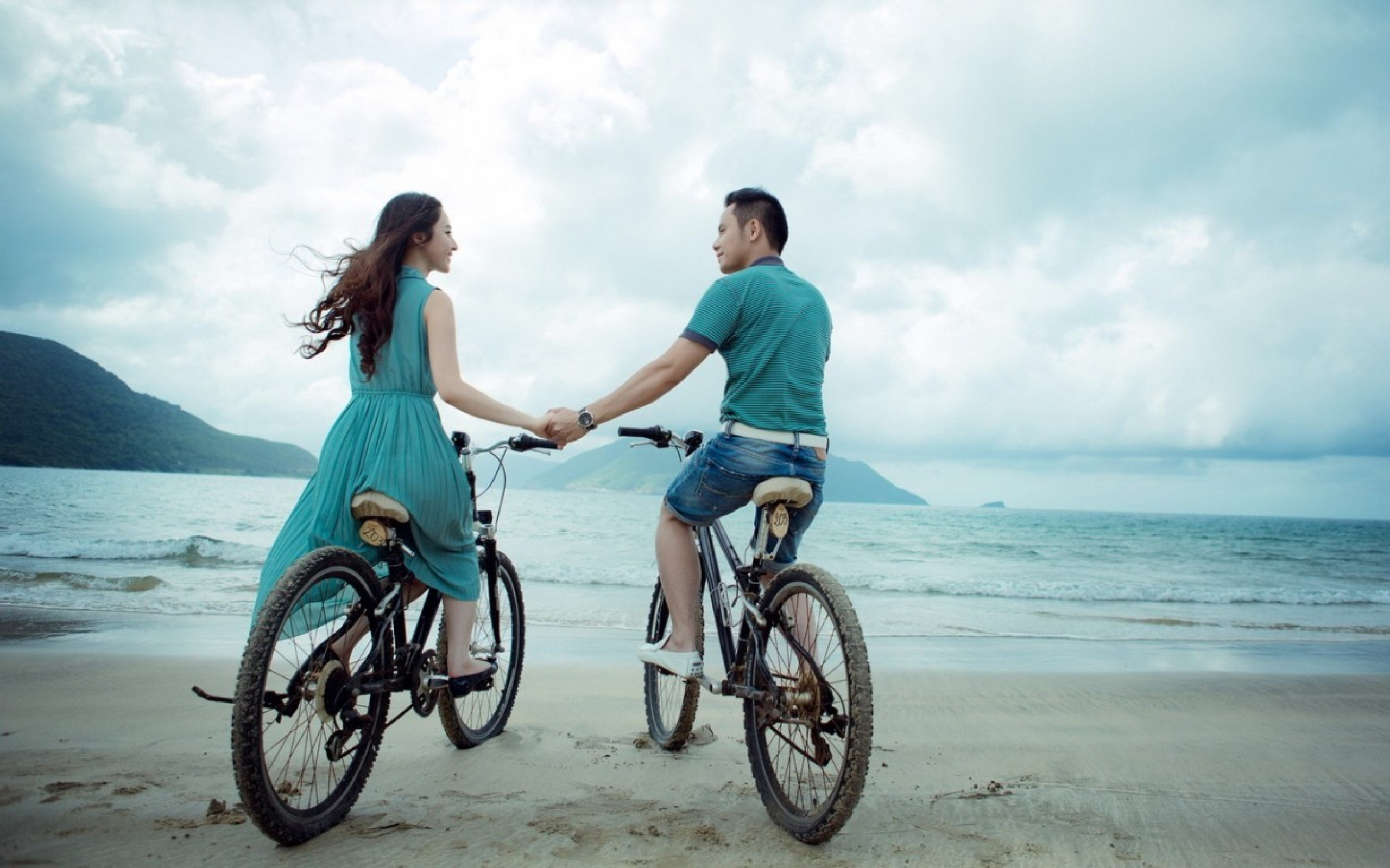 couple bicycle riding on