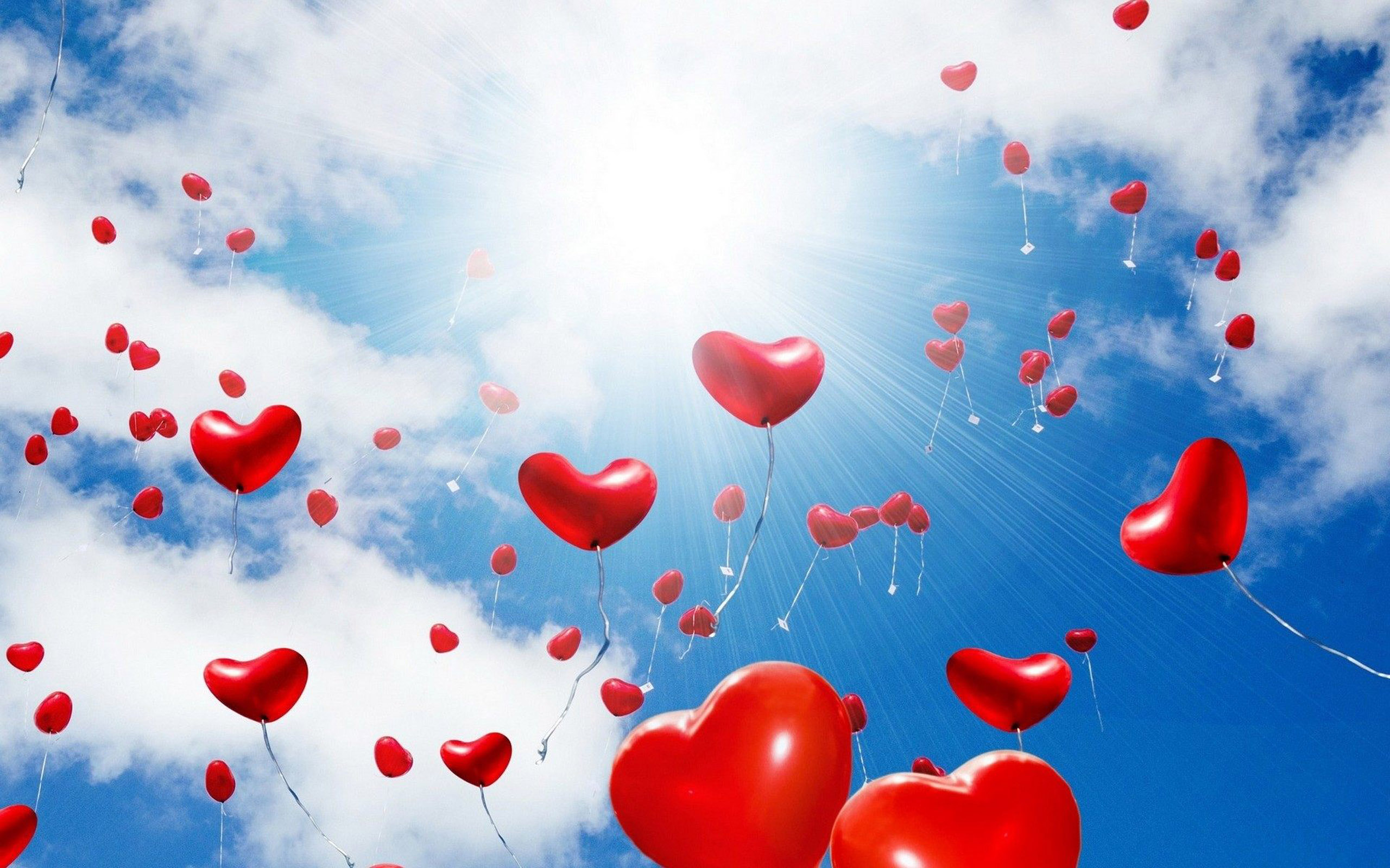 Red Balloons In The Shape Of A Heart Sunlight Blue Sky