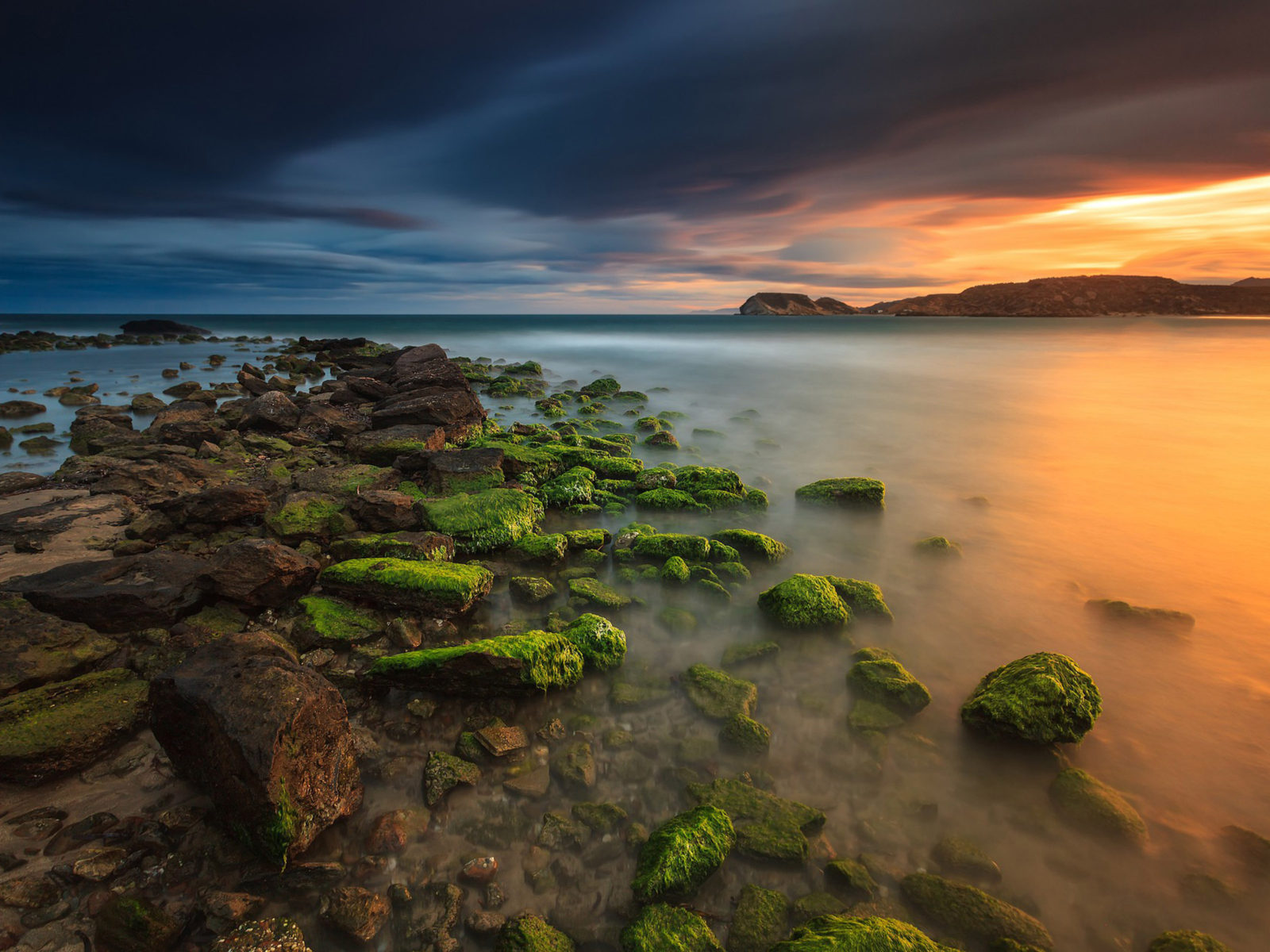 Animals Wallpapers For Mobile Free Download Sunset In Spain Coast Rocks With Green Moss Sea Reflection
