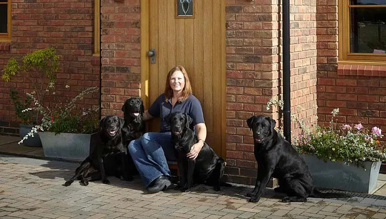 Sarah Wall outside Walls4Paws dog boarding hotel