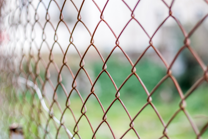 How to Maintain a Chain-Link Fence