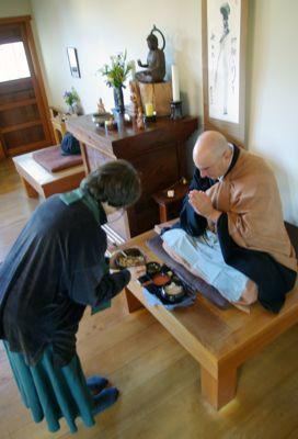 Laurie Senauke demos serving oryoki breakfast to Hozan Alan Senauke at BZC.