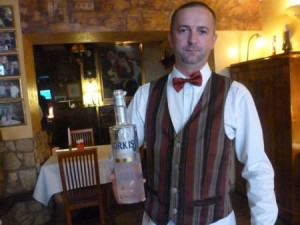 Polish waiter waiter Mariusz Scetlak with spelt vodka at Pod Baranem.