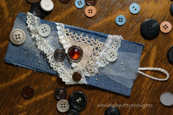 Denum cuff with tatting, lace, and buttons on wandasknottythoughts