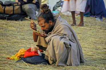 Getting ready after a dip in the Sangam