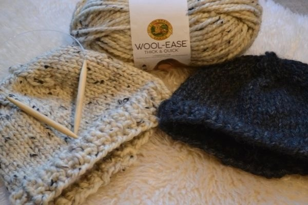 how to knit a hat, two knit hats on carpet