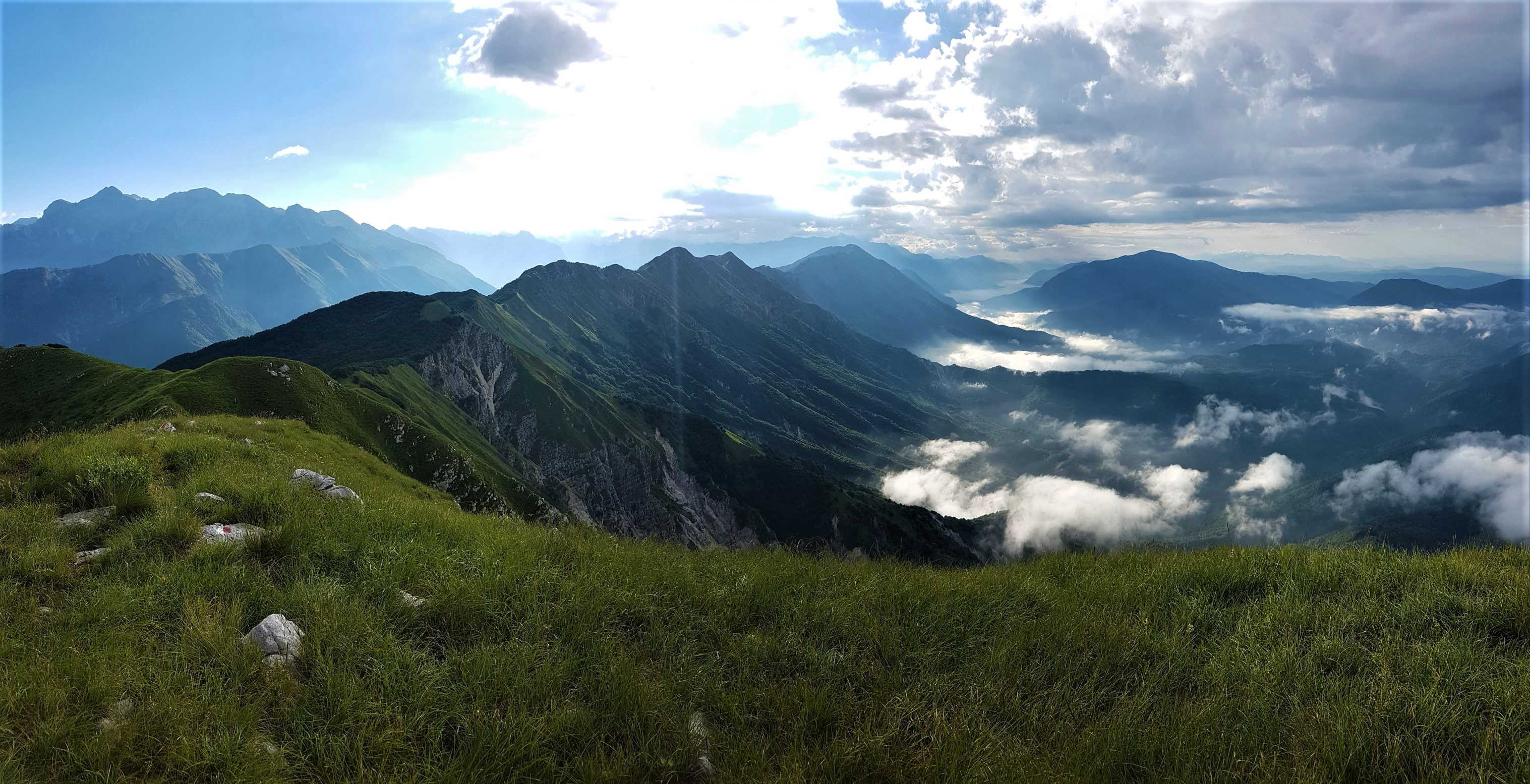 The peak of my photographic career.  Looking back along the Stol ridge towards Slovenia from Italy