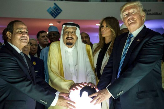 Donald Trump and Saudi leaders touching orb