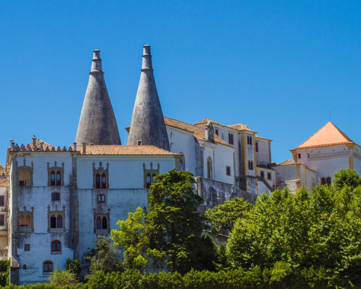Chimney spires of Sintra, Portugals National Palace rise above the surrounding architecture