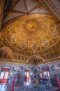 A royal room lined with coats of arms in Sintra, Portugal