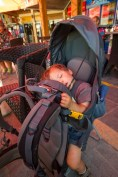 Child naps in a kid carrier in Jordan - helping kids find nap time on the road