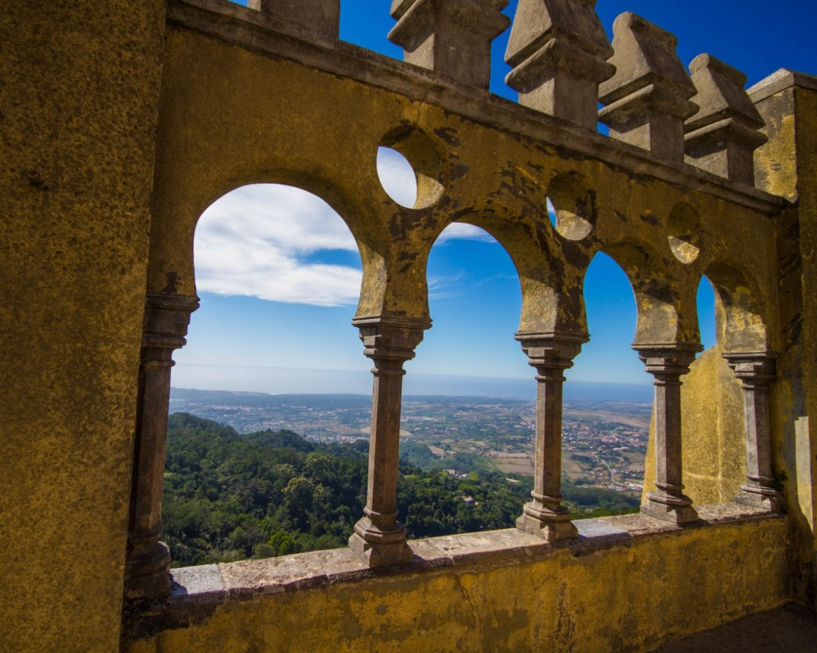 Looking out over Sintra, Portugal and it's surrounding lush forests from the detailed ramparts of Pena Palace