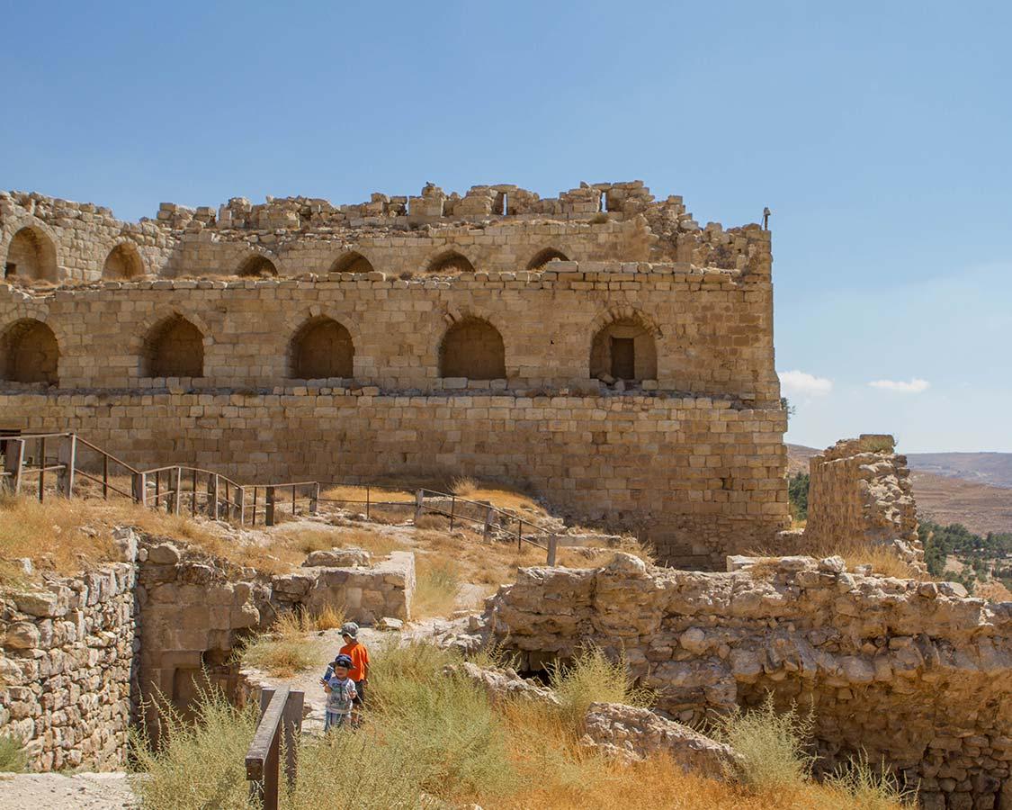 Boys play at Karak Castle Jordan with kids