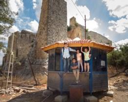 Children climbing on building near Aljoun Castle - Traveling Jordan with Kids