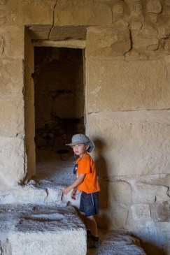Young boy explores rooms of a castle