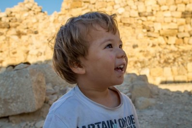 Toddler smiling in a rocky desert